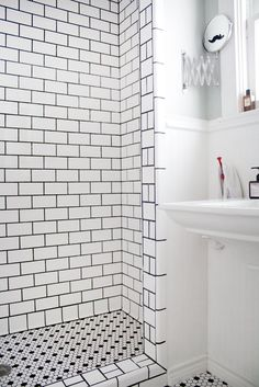 I like the graphic element that the black grout gives the white subway tile, especially with the hex floor tile. Eric's Stylish, Sunshine-Filled House House Tour | Apartment Therapy