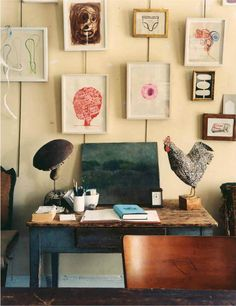 eclectic gallery wall; interesting collection of objects & art, painted table