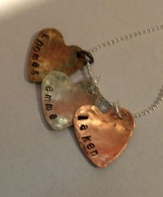 Three hammered custom stamped hearts. One antiqued sterling silver filled one copper and one sterling silver filled. Comes on a black cord! $25. You can also add a chain!