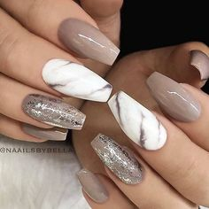 Brown nude, coffin nails with glitter and white marble accent nails. #glam