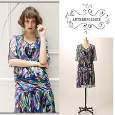 """Anthropologie colorful abstract dress Guy Baxter for Anthropologie Palette Study Dress. Only worn once, like new conditon. This is a perfect holiday party dress! 3/4 sleeves, front tie can be worn open or tied. Ties in back so you can wear it looser or fitted. Measures 38"""" from shoulder to hem. Size 4 Anthropologie Dresses"""