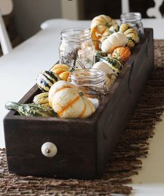 Dark Walnut Box with Gourds | These DIY jars will shine as centerpieces.