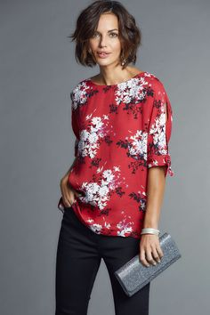 Printed Cold Shoulder Top - This seasons must-have style, the cold-shoulder top! This fashionable floral printed top has ties on the cold shoulder for that extra detailing, teamed perfectly with black trousers or dark denim jeans.