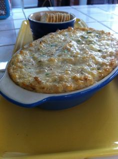 Louisiana hot crab dip: 1/2 lb lump crabmeat, 8 oz cream cheese, 1/2 cup mayonnaise, 1/4 cup grated Parmesan, 3 T minced green onions (white and green parts), 2 large garlic cloves, minced, 2 t Worcestershire, 2 T lemon juice, 1 t hot sauce, 1/2 t Old Bay, S to taste. Combine all of the ingredients in a casserole dish and gently stir until thoroughly mixed. Bake in 325 deg oven 40 mins