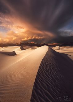 An impressive cloud formation passes over the Mesquite sand dunes in Death Valley National Park