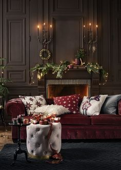 Deep red velvets with soft greys and whites work brilliantly together at Christmas time to create a warm and cosy feeling. Accessorise with plush, patterned cushions, and add twinkly fairy lights for a festive touch. (Photo: H&M Home)