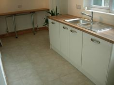 Worktops are Howdens Wild Walnut Laminate.this also houses an integrated washing machine and dishwasher.  http://www.ppmsltd.co.uk