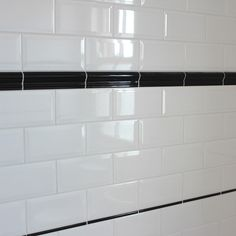 Bevelled edge ceramic wall tile, gloss white finish in a solid colour, ideal for kitchens or bathrooms