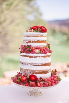 Wedding cake with strawberries | Brides.com | Photo: Sara Lynn Photographic
