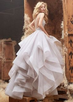 Style HP6413 2  Alabaster tulle bridal gown with halter high neck alabaster and crystal bodice, full horse hair flounced skirt and chapel train.