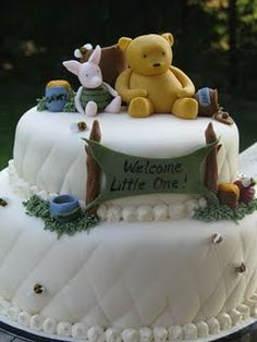 party ideas Winnie the Pooh Cake. Perfect for a baby shower or first birthday.