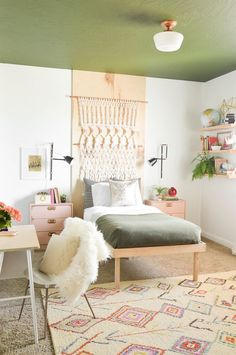 Such a cute, creative, bohemian little girls bedroom! Love the idea of painting the ceiling to take your focus off of the carpet! from Vintage Revivals