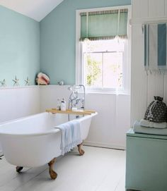 Affordable Decorating Ideas -from Country Living Secrets to Effortlessly Affordable Style.A mother-daughter decorating duo share their strategies for making any home look like a million bucks. Painted Wood Floors, Primitive Bathrooms, Upstairs Bathrooms, Downstairs Bathroom, Decorating On A Budget, Home Look, Home Remodeling, Bathtub, Clawfoot Tubs