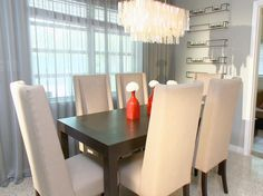 This small contemporary dining room has a sleek design with an elegant Capiz shell chandelier as the focal point.