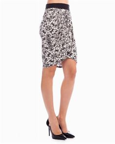 Teamed with a classic white button-down for the day or with an embellished tank for the night, this printed tulip skirt offers multi-use style.
