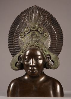 A very fine quality patinated bronze representing a south east asian woman bust with her flowered head cover. This model is not signed...