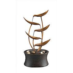 @Overstock.com - Natura Tabletop Metal Leaf Water Fountain - Turn any room into a day spa where you can rest and relax with this elegant tabletop water fountain. The gentle sounds of water splashing off the metal leaves and rocks below will help lull you to sleep, and it comes with a pump and power cord.  http://www.overstock.com/Home-Garden/Natura-Tabletop-Metal-Leaf-Water-Fountain/6431219/product.html?CID=214117 $58.99