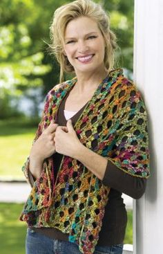 The openwork pattern is really different from your usual crochet openwork. The multicolored yarn helps it along, although I think I would choose a different blend. #crochet #wrap #shawl