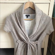 Anthropologie sweater Beautiful, versatile anthropologie shawl collar sweater with crossover detail on front.  Short sleeve.  Closes with 2 covered buttons.  Neutral tan/grey/cream tones go with everything.  EUC.  (this listing is for sweater only.) Anthropologie Sweaters Cardigans