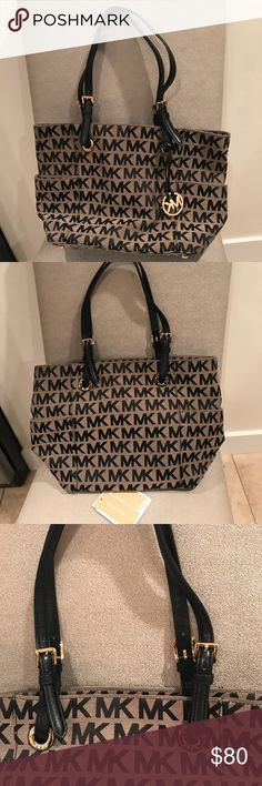 "Michael Kors Travel Monogram Bag Black and Beige Canvas Jet Set MK Monogram Tote Very Good condition. Kept immaculate by my mother! Functional and comfortable to wear. No stains or defects. 11.5""L x 10""H x 5.5""W Michael Kors Bags Totes"