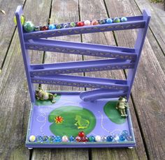 Old fashioned wooden toy marble run ~ little green frogs, purple! Old Fashioned Toys, Green Frog, Marbles, Handmade Toys, Frogs, Fathers Day Gifts, Wooden Toys, Gifts For Kids, Whimsical