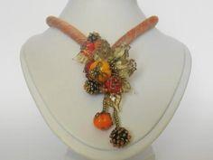 """Deze """"Colorful necklace"""" is gemaakt met een speciaal gevuld zijden koord dat zeg maar gestreept is in de tinten oranje/bruin, de dikte van het koord is +/- 9mm. Op het koord zitten rozenknopjesin in een hele lichte creme tint en verschillende pompoentjes. Tussen dit alles zitten kleine transparante blaadjes, besjes en kleine roccailles. Necklaces, Chain, Wedding Necklaces"""