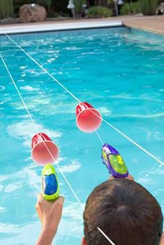 Squirt Gun Races: This elaborate obstacle course will be perfect for your next pool party. Your kids will love using squirt guns to move the cups across the pool. party Fun Swimming Pool Games for Your Kids to Play This Summer Swimming Pool Games, Cool Swimming Pools, Pool Fun, Play Pool, Kids Swimming, Kiddie Pool, Pool Party Games, Pool Party For Kids, Pool Party Birthday