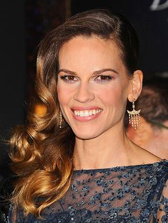 GO DEEP    Celeb hairstylist Robert Vetica emphasized a deep side part to achieve the glamorous look Hilary Swank sported at the L.A. premiere of New Year's Eve. A dramatic part is a quick and simple way to change up your style and try something high-impact. Vetica ensured that Hilary's locks stayed smooth and frizz-free by using Moroccanoil Treatment while blow-drying.