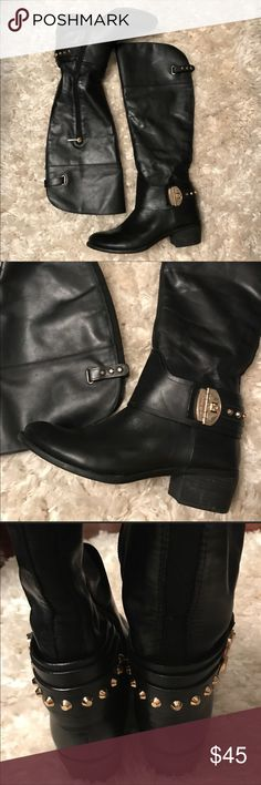 Vince Camuto knee high boots 100% authentic Knee high boots with gold details around the ankle and behind the knee they have elastic behind from the ankle up through the knee great condition worn a few times  They've been sold before but the the Costumer returned them back because I put a wrong size on display I right they are 9 but actually they are 9 1/2 Vince Camuto Shoes Combat & Moto Boots