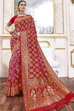 Red And Pink viscose saree with red viscose blouse. Embellished with woven zari work. Saree with Sweetheart Neckline, Elbow Sleeve. It comes with unstitch blouse, it can be stitched to 32 to 58 sizes. #weddingsaree #weddingwearsaree #festivalwear #partywearsaree