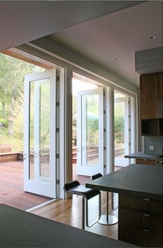 Although I can't help but think there could be so much wasted cabinet space with this.. I would LOVE to have doors like this with screens to open on pretty days. Especially in the kitchen.