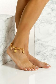This is a slim leather anklet handmade with 24k gold or silver plated embellishments which means they don't tarnish with sun. It comes in two colors, black & natural tan. Wear it with cropped hemlines all summer long layered or solo. Greek Chic Handmades jewelry are designed and handcrafted in Athens, Greece from the best quality leather and nickel free hardware. Find your favs! Gold Anklet, Beaded Anklets, Anklet Bracelet, Bracelets, Hanging Beads, Ankle Chain, Natural Tan, Bohemian Jewelry