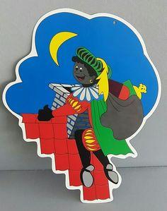 Etalagebord Zwarte Piet op het dak