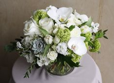 Soft phalaenopsis orchids and hearty succulents are the perfect additions to this white and cream floral. Learn more about our local floral delivery here! Phalaenopsis Orchid, Orchids, Flower Delivery, Tulips, Flower Arrangements, Succulents, Floral Wreath, Flowers, Roses