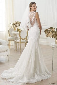 I am in love with the style of this dress: lace, back-less, short train, flowers.   Pronovias 2014 Fashion pre-collection