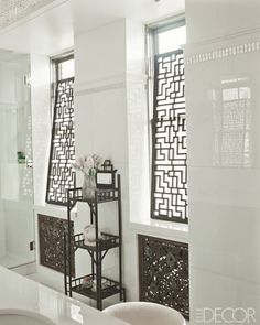 fretwork panels screening master bathroom windows