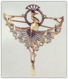 Diamond, moonstone, pearl, plique-à-jour enamel, enamel, silver and gold peacock brooch, by Lalique, circa 1900.