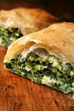 Greek Spanakopita Strudels _ I'm brushing up on my favorite Greek recipes. In strudel form, spanakopita assumes an almost breakfast croissant-like character, a perfect bundle of flaky pastry, egg, cheese, & greens. Isn't everything more delicious when baked in small packages? Yum!