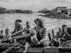 Cambodian floating people - They're living on the water because can't buy land. tonlesap lake,Cambodia.