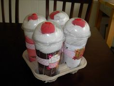 """Contains 4 Onesies, 4 Diapers, 8 White Wash Cloths, 4 red """"cherry"""" socks in clear cups with dome lid"""