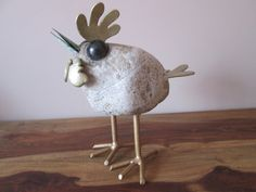 Hen sculpture handmade out of stone, patinated copper (beak) and corrosion-protected steel.