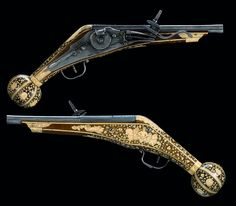 A pair of ornate wheel-lock pistols originating from Augsburg, Germany, dated 1586.