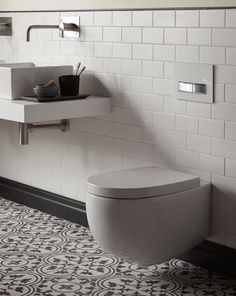 Nice floor tiles, wall tiles and space saving sanitaryware