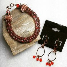 Custom ordered antique copper Viking Knit bracelet with red glass beads and rose gold spiral end caps and custom antique copper earrings with dangle red beads. Customer bought a necklace from me last month and asked for a bracelet and earrings to match. Hoping they are to her liking!