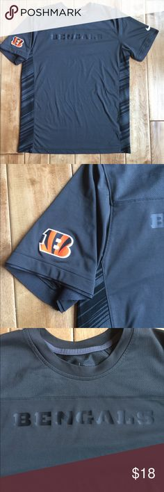 Nike NFL Bengals DRI-FIT Tee NFL Bengals Nike DRI-FIT tee.  Moisture wicking short Sleeve shirt.  Main body is dark grey, with black stripping on the side. Size Large.  EUC. Nike Shirts Tees - Short Sleeve