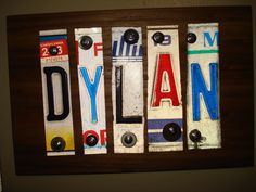 My dad made this for my son's room out of old license plates.  Cool!