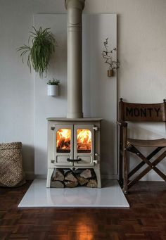 Browse the Vlaze Designer Range, quality fireplace heatshields, surrounds and hearths, available for installation across North Wales. Wood Stove Surround, Wood Stove Hearth, Wood Burner Fireplace, Fireplace Hearth, Home Fireplace, Fireplace Design, Concrete Fireplace, Fireplace Surrounds, Fireplaces