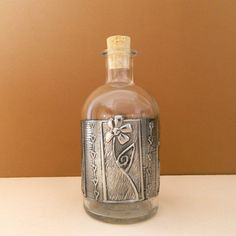 Glass Bottle Pewter Embossed Flower Motif by Loutul on Etsy, £13.00