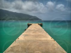 Photo by Erick Redcloud - This pier off to the beautiful green and blue Caribbean waters is shot on Playa Blanca in the town of La Miel, Panama near the boarder of Colombia.