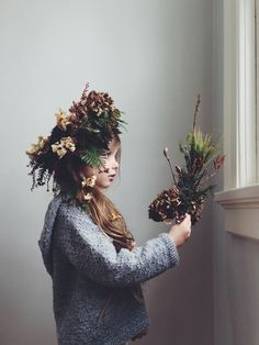 Elle with a winter gathered woodland crown and bouquet.